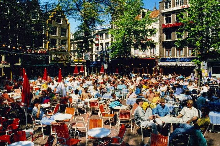 Holland,Amsterdam,people sitting at outdoor cafe in Leidseplein